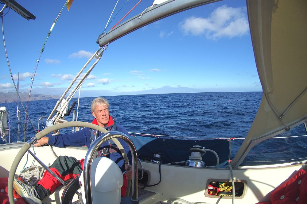 Relaxed sailing. El Teide, Spsin's highest mountain in the behhind